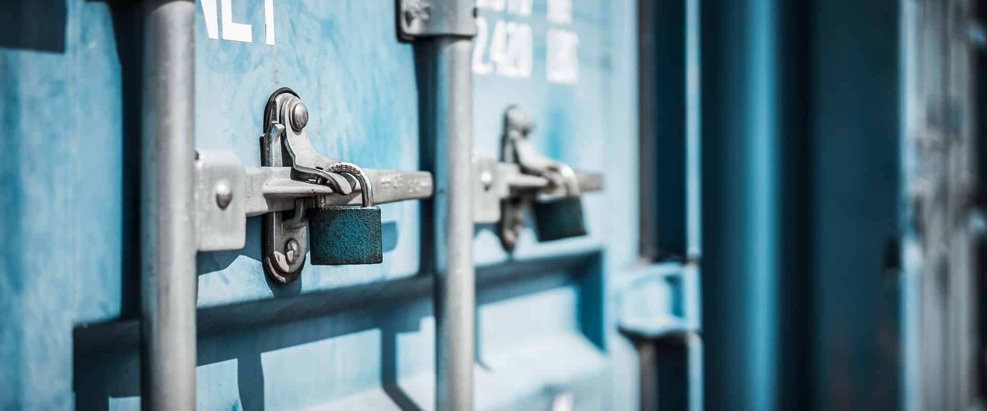 Light blue shipping containers with locks